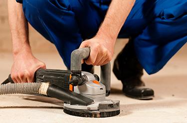 hand-held concrete grinding tool