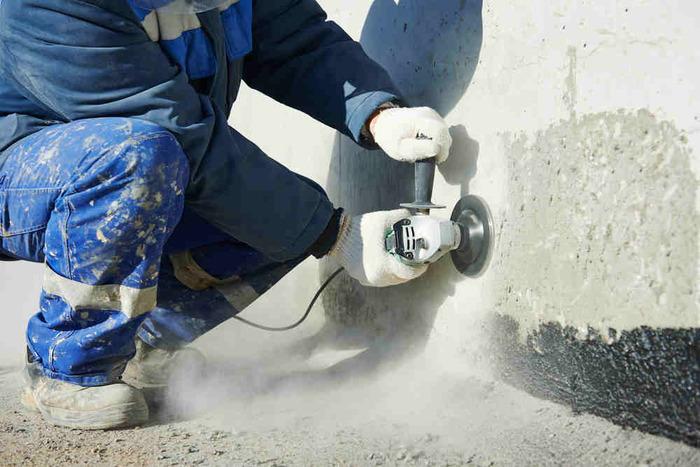 man concrete grinding