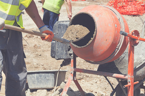 adding cement in mixer
