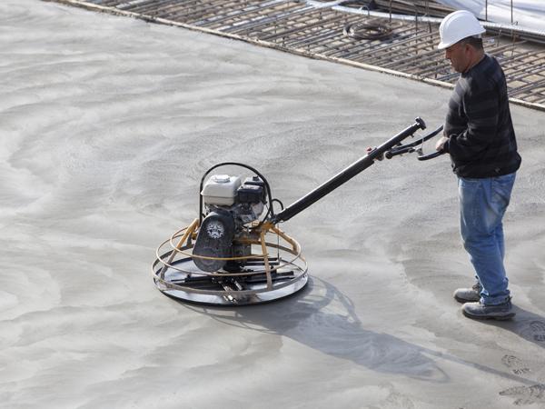 person preparing a concrete floor 1