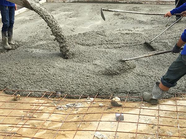 pouring cement in floor
